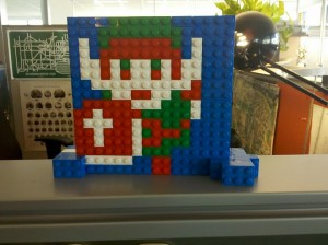 It's Link. The 8-bit sprite from The Legend of Zelda. In LEGO.