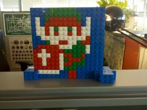 It's Link. The 8-bit sprite from The Legend of Zelda. In LEGO.